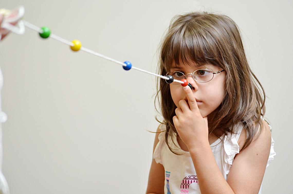 girl doing brock string vision therapy